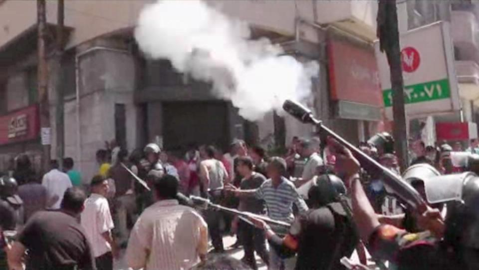 In this image made from video, police fire tear gas at supporters of ousted President Mohammed Morsi in Alexandria, Egypt on Wednesday, Aug. 14, 2013. (AP Photo/APTN)