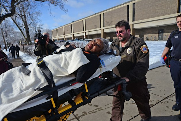 Emergency personnel brings an injured person out on a stretcher after a fight brought ambulances and police to the South High School in Minneapolis on Thursday, Feb. 14, 2013. The school is on lockdown after a food fight got out of hand and turned into a real fight. Minneapolis police were called after the fight broke out during third-period lunch around 12:45 p.m. Thursday. The fight lasted 15 minutes. The school says staff members responded immediately and took security steps. Teaching continues as usual during the lockdown, but students will remain in their classrooms during class. South will remain on lockdown until further notice.(AP Photo/The Star Tribune, Richard Sennott) MANDATORY CREDIT; ST. PAUL PIONEER PRESS OUT; MAGS OUT; TWIN CITIES TV OUT
