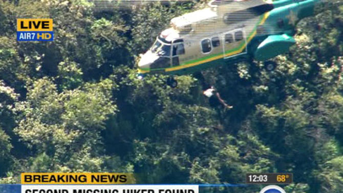 This video image provided by KABC-TV shows the air rescue of Kyndall Jack, 18, who was hoisted out of Cleveland National Forest, California, after being missing for four days, Thursday April 4, 2013. Her hiking companion, Nicolas Cendoya, 19, was discovered without shoes by another hiker Wednesday less than a mile from where the pair's car was parked. (AP Photo/KABC-TV)