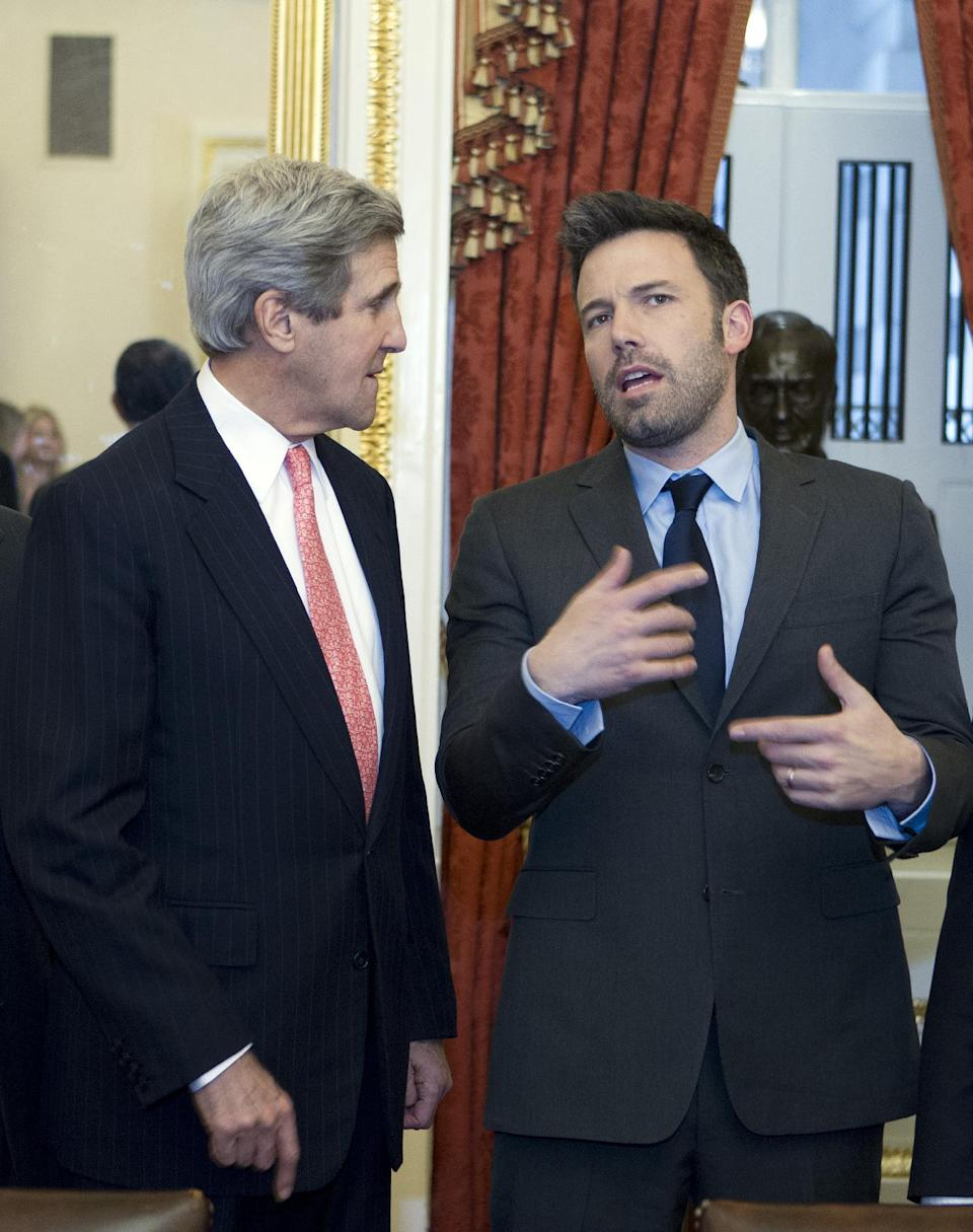 Sen. John Kerry D-Mass., speaks with actor Ben Affleck during a meeting with foreign relations members to discus the crisis in the Democratic Republic of Congo on Capitol Hill in Washington on Wednesday, Dec. 19, 2012. (AP Photo/Jose Luis Magana)