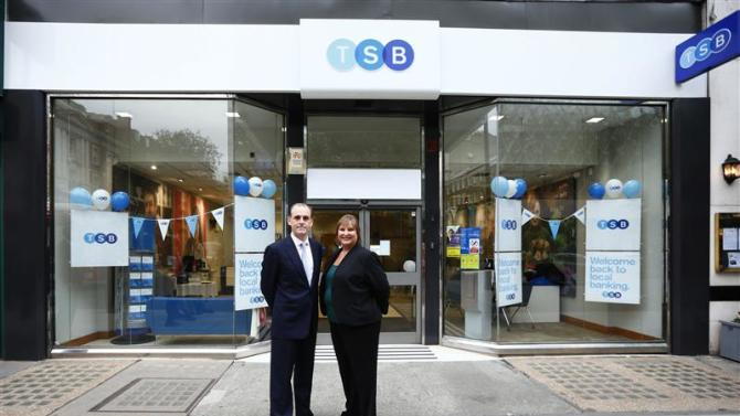 Chief Executive of the TSB bank Paul Pester and Lloyds Banking Group Group Retail director Alison Brittain pose outside the TSB Baker Street branch in London