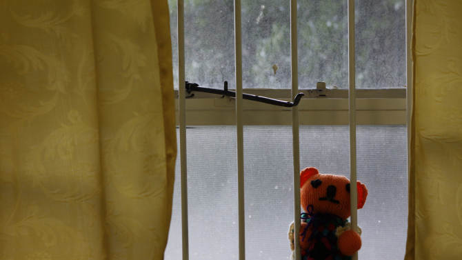A teddy bear is placed on a windowsill at the Teddy Bear Clinic, where abused children are treated, in Johannesburg, Friday, Feb. 9, 2013. In a country where one in four women are raped and where months-old babies and 94-year-old grandmothers are sexually assaulted, citizens are demanding action after a teenager was gang-raped, sliced open from her stomach to her genitals, and left for dead on a construction site last week. (AP Photo/Denis Farrell)