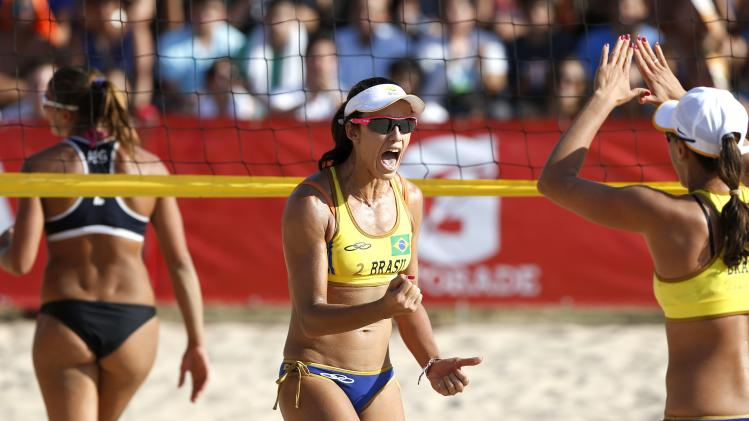 Brazil's Talita Antunes and Taiana De Sousa celebrate after winning their women's gold medal volleyball beach match in Santiago