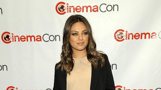 "FILE - In this Tuesday April 24, 2012 file photo, Mila Kunis, a cast member in the upcoming film ""Oz: The Great and Powerful,"" poses before the Walt Disney Studios Motion Pictures presentation at CinemaCon 2012, the official convention of the National Association of Theater Owners, in Las Vegas. Prosecutors on Thursday May 17, 2012 charged Stuart Lynn Dunn, 27, of stalking the actress and violating a restraining order granted earlier this year after Dunn was found inside a vacant condo unit owned by the actress. (AP Photo/Chris Pizzello, File)"