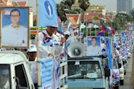 Cambodian supporters of the opposition Sam Rainsy party campaign in Phnom Penh in May 2012. Cambodia's two main opposition parties have joined forces to challenge Prime Minister Hun Sen's 27-year grip on power at a general election next July, a spokesman for the new group said Wednesday