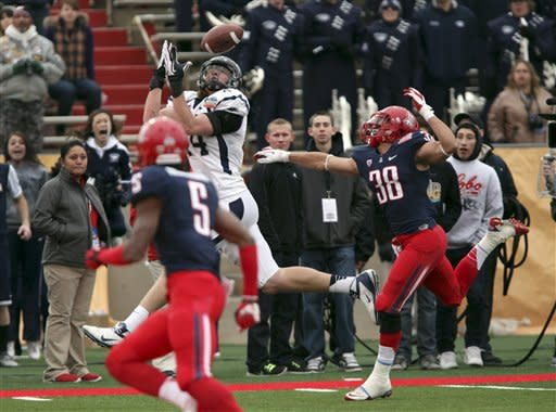 Arizona overcomes Nevada 49-48 in New Mexico Bowl