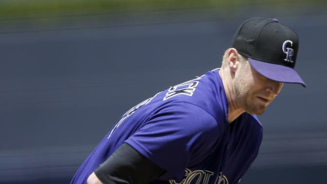 Colorado Rockies starting pitcher Kyle Kendrick cannot reach a ball hit by San Diego Padres' Wil Myers during the first inning of a baseball game Sunday, May 3, 2015, in San Diego. (AP Photo/Gregory Bull)