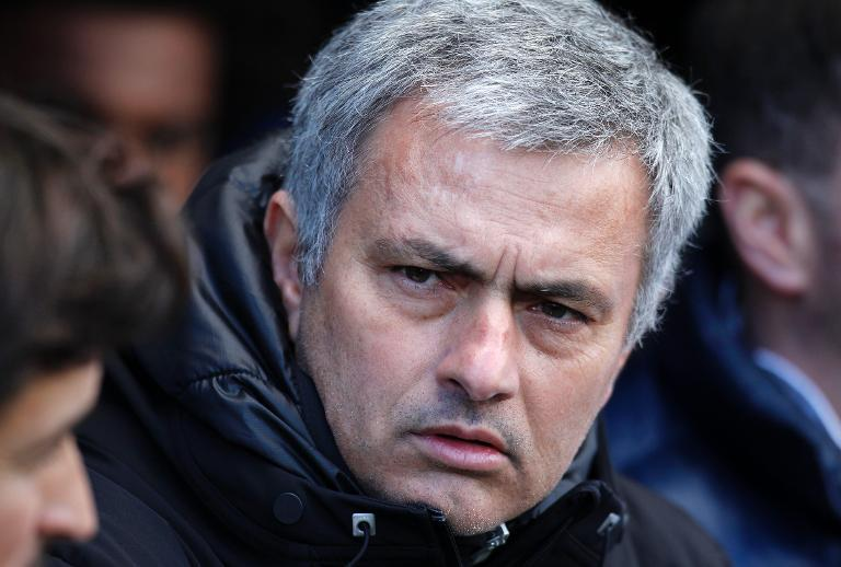 Chelsea's manager Jose Mourinho awaits kick-off of their English Premier League match against Fulham, at Craven Cottage in London, on March 1, 2014