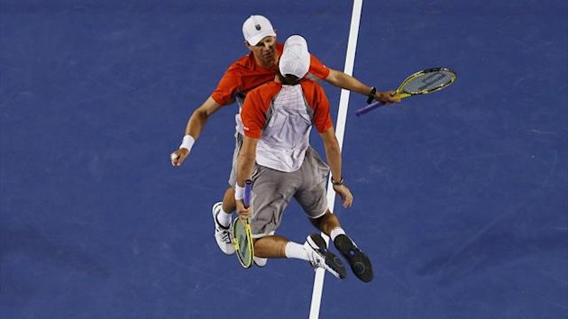 Bob and Mike Bryan celebrate victory with a flying chest-bump (Reuters)