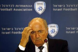 FIFA President Blatter reacts during a news conference in Jerusalem