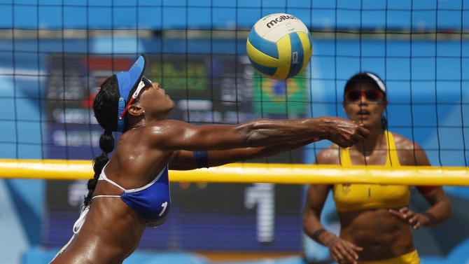 Puerto Rico's Yarleen Santiago returns the ball during a women's beach volleyball semifinal match against Brazil at the Pan American Games in Puerto Vallarta, Mexico, Thursday, Oct. 20, 2011.  (AP Photo/Ariana Cubillos)