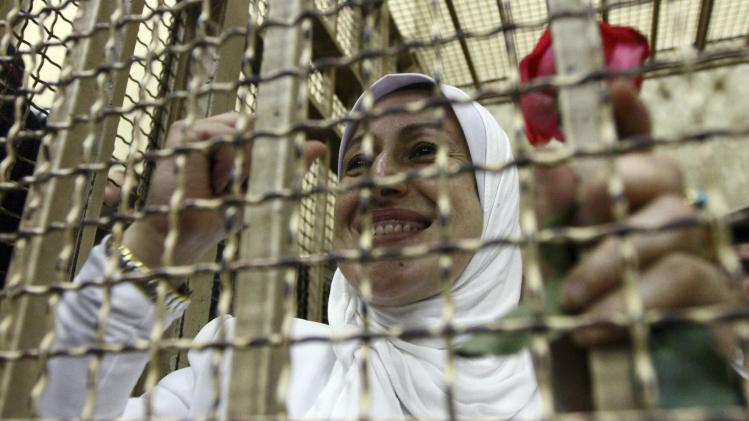Mohamed, who was found guilty along with other women and girls of obstructing traffic during a pro-Islamist protest in October, smile during an appeal hearing at a court in the Mediterranean city of Alexandria