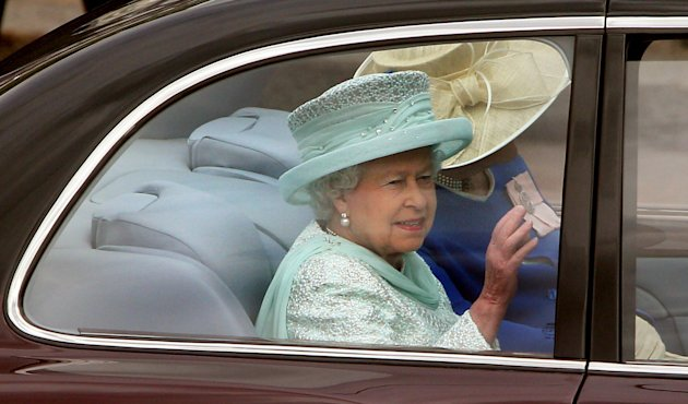 Britain's Queen Elizabeth II leaves Buckingham Palace, London, for a service of thanksgiving at St Paul's Cathedral as the Diamond Jubilee celebrations continue. Tuesday June 5, 2012. (AP Phot