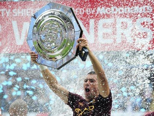 Man City's Aleksandar Kolarov lifts the FA Community Shield trophy