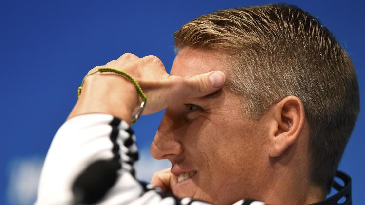 Germany's Schweinsteiger listens to a question during a news conference at the Maracana stadium in Rio de Janeiro