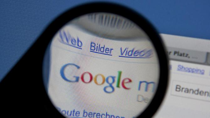 File - In this Nov. 18, 2010 file photo, a magnifying glass is used to illustrate an excerpt from the Top Internet Service Goggle Maps, recorded in Bremen, Germany. Google Inc., releases quarterly financial results Thursday, Oct. 13, 2011, after the market close. (AP Photo/dapd, Joerg Sarbach, File)