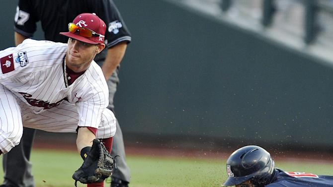 Arizona's Joseph Maggi, right, reaches second on a double ahead of the throw to South Carolina second baseman Chase Vergason in the third inning of Game 2 of the NCAA College World Series baseball finals in Omaha, Neb., Monday, June 25, 2012. (AP Photo/Eric Francis)