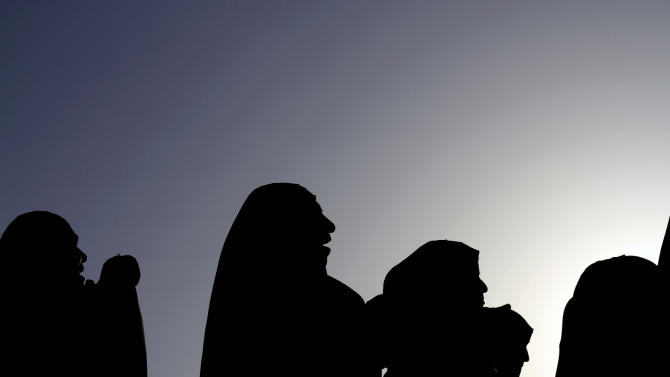 Bahraini anti-government protesters shout slogans during a rally in Sitra, Bahrain, on Wednesday, Feb. 13, 2013. Clashes erupted in several opposition villages around the kingdom on the eve of the second anniversary of a pro-democracy uprising. (AP Photo/Hasan Jamali)