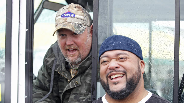 Frequent heartburn sufferer and comedian Larry the Cable Guy, left, and former nose tackle Gilbert Brown, right, tailgate with fans in Green Bay to promote new Prilosec OTC Wildberry and encourage fans to enter the Wild American Flavor Sweepstakes at www.wildberryflavor.com, on Sunday, Dec. 9, 2012 in Green Bay, Wis. (Photo by Matt Ludtke/Invision for Prilosec OTC/AP Images)