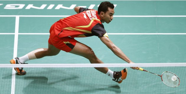 Indonesia's Tommy plays a shot during his singles match against China's Chen at the quarterfinals of the Sudirman Cup World Team Badminton Championships in Kuala Lumpur