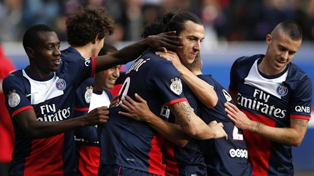 Paris St Germain's Zlatan Ibrahimovic celebrates with team-mates after scoring a goal for the team during their French Ligue 1 soccer match against Bastia at the Parc des Princes Stadium in Paris October 19, 2013 (Reuters)