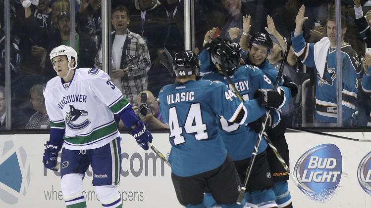 Sharks beat Canucks 4-1 in season opener