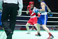 Katie Taylor (L) of Ireland clashes with Sofya Ochigava of Russia during bout at the Women's World Boxing Championships in China in May 2012. Taylor, the 25-year-old having won her fourth successive world title in China