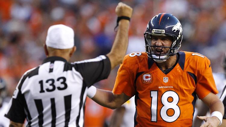 Denver Broncos quarterback Peyton Manning (18) argues with back judge Steve Freeman (133) during the first quarter of an NFL football game against the Pittsburgh Steelers, Sunday, Sept. 9, 2012 in Denver. (AP Photo/David Zalubowski)