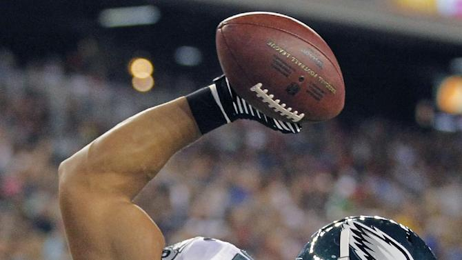 Philadelphia Eagles tight end Clay Harbor (82) spikes the ball after his touchdown reception against the New England Patriots during the second quarter of an NFL preseason football game in Foxborough, Mass., Monday, Aug. 20, 2012.(AP Photo/Steven Senne)