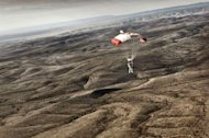 Austrian athlete Felix Baumgartner descending to the desert after successfully completing the second manned test flight for Red Bull Stratos in Roswell, New Mexico, USA on July 25, 2012