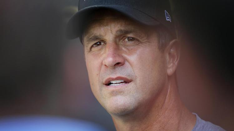 Baltimore Ravens head coach John Harbaugh listens to a reporter's question during a news conference after a workout at NFL football training camp, Tuesday, July 22, 2014, at the team's practice facility in Owings Mills, Md. (AP Photo)