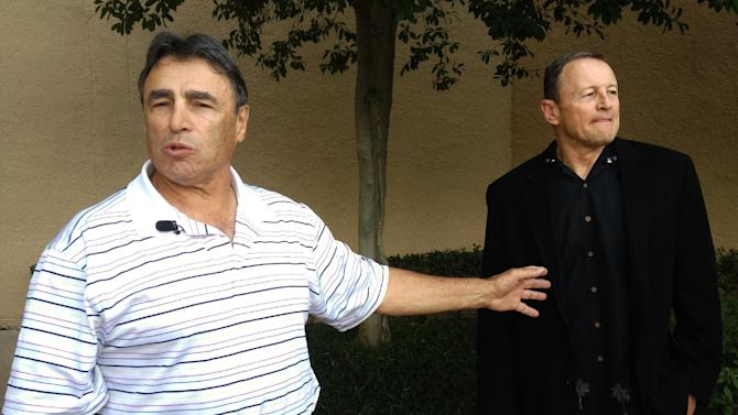 NFL head linesman Tom Stabile, left, and referee Ed Hochuli arrive at an Irving, Texas hotel Friday, Sept. 28, 2012. Officials started arriving Friday to discuss and vote on an agreement reached with the league late Wednesday. Some planned to fly directly to their assigned cities for Sunday's game. The deal must be ratified by 51 percent of the union's 121 members. (AP Photo/Nomaan Merchant)