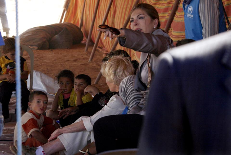 Quentin Bryce, the Australian Governor-General, speaks to Syrian refugee children at the Zaatari Syrian Refugee Camp, in Mafraq, Jordan, Sunday, Sept. 2, 2012. Bryce told the press that Australia has contributed 20 million in funds to support the refugees. (AP photo/Mohammad Hannon)