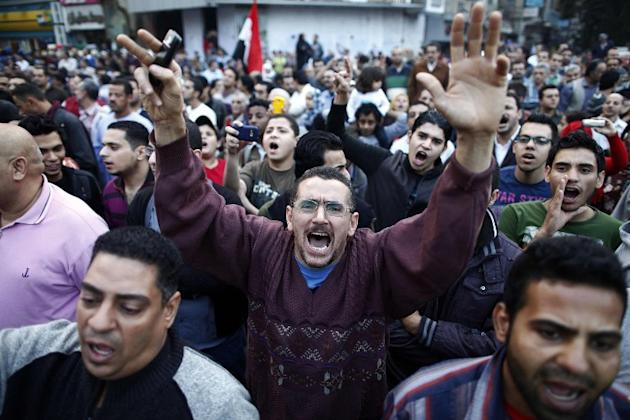 Protesters shout slogans as they march to join the tens of thousands people taking part in a mass rally against a decree by President Mohamed Morsi granting himself broad powers on November 27, 2012 a