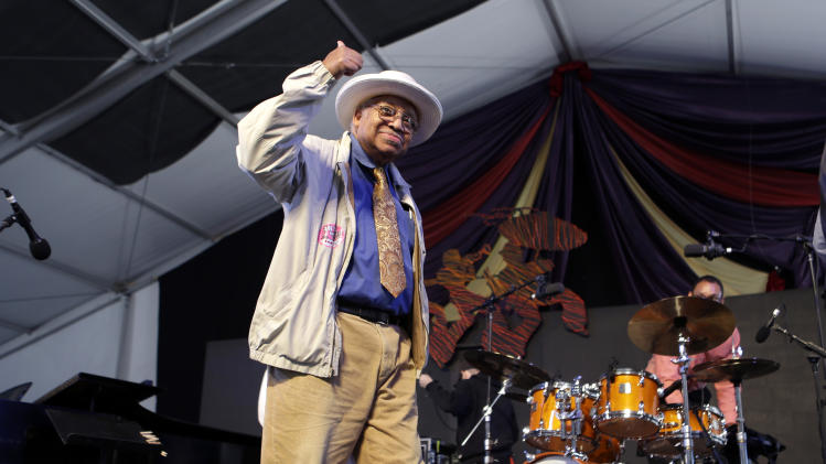 Jazz Pianist Ellis Marsalis, father of musicians Wynton Marsalis, Branford Marsalis, Delfeao Marsalis and Jason Marsalis, acknowledges the crowd after performing at the New Orleans Jazz and Heritage Festival in New Orleans, Sunday, May 5, 2013. His son Jason is seen on the drums in background. (AP Photo/Gerald Herbert)