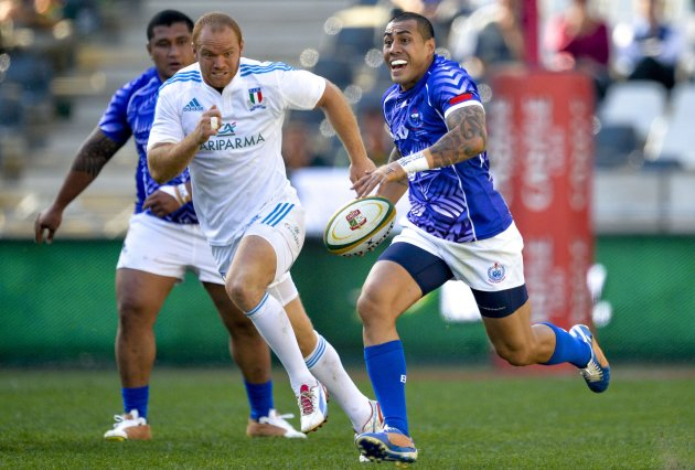 Samoa's Tusi Pisi breaks past Italy's Mauro Bergamasco during their rugby union Test match in Nelspruit