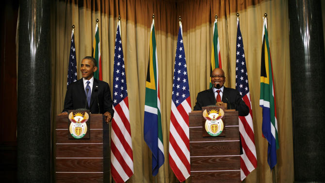 U.S. President Barack Obama and South African President Jacob Zuma address a press conference following their meeting at Union Building in Pretoria, South Africa, Saturday June 29, 2013.(AP Photo/Jerome Delay)