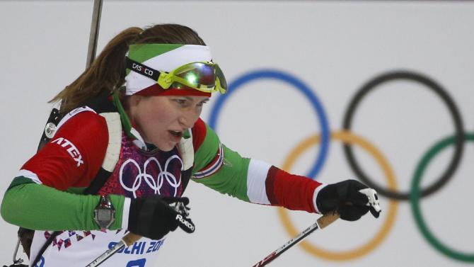 Domracheva wins Olympic gold in 10K pursuit