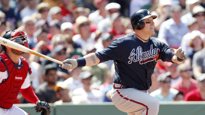 Atlanta Braves' Eric Hinske, right, watches his two-run triple in front of Boston Red Sox's Kelly Shoppach in the fifth inning of a baseball game in Boston, Sunday, June 24, 2012. (AP Photo/Michael Dwyer)