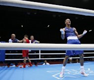 Anthony Ogogo (R) of Great Britain celebrates victory over Ievgen Khytrov of the Ukraine in their Middleweight (75kg) match of the London 2012 Olympic Games at the ExCel Arena, on August 2. Ogogo was awarded a razor-thin points victory