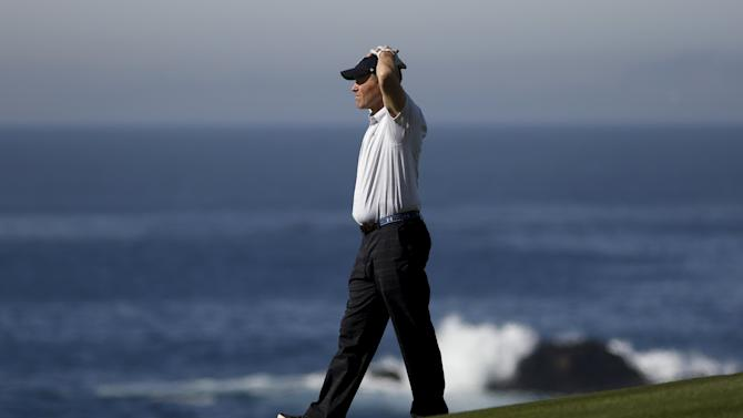 Dave Calhoun walks down the ninth fairway during the first round of the Pebble Beach Pro-Am golf tournament