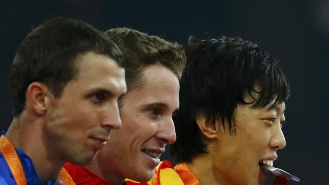 Third placed Bondarenko of Ukraine, first placed Drouin of Canada and second placed Zhang of China pose during the medals ceremony after the men's high jump final at the 15th IAAF World Championships at the National Stadium in Beijing