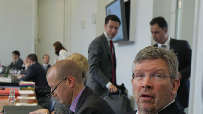 Mercedes principal Ross Brawn, is seen prior to the hearing at the FIA headquarters in Paris, Thursday, June 20, 2013. The hearing to determine whether Mercedes and Pirelli broke Formula One rules by holding in-season tire tests has opened in Paris.  The International Automobile Federation (FIA) convened the international tribunal hearing to determine whether Mercedes gained a competitive advantage from the testing session in Barcelona last month. (AP Photo/Michel Euler, Pool)