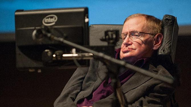 "In this photo provided by Cedars-Sinai, British cosmologist Stephen Hawking, who has motor neuron disease, gives a talk titled  ""A Brief History of Mine,"" to workers at Cedars-Sinai Medical Center in Los Angeles, on Tuesday, April 9, 2013. (AP Photo/Cedars-Sinai, Eric Reed)"