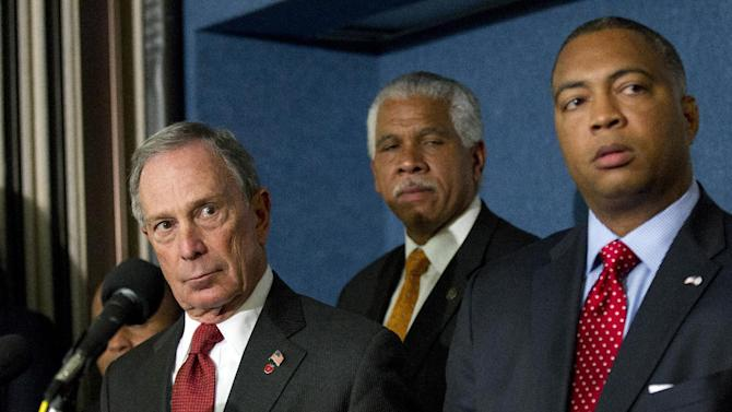 """From left, New York City Mayor Michael Bloomberg NAACP Washington Bureau Director and Senior Vice President for Advocacy Hilary Shelton, and incoming Florida Senate Minority Leader Chris Smith, take part in a news conference at the National Press Club in Washington, Wednesday, April 11, 2012, to annunce a nationwide campaign to reform or repeal Florida-style """"Shoot First"""" laws that have passed in states across the country.     (AP Photo Manuel Balce Ceneta)"""