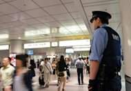 A Japanese policeman patrols a Tokyo railway station in June 2012. Three men suspected of dismembering and barbecuing the remains of their victim are being held by authorities in Japan, police and reports say