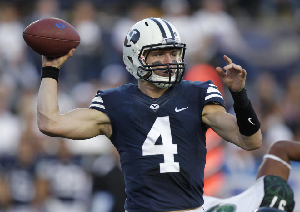 Brigham Young quarterback Taysom Hillt hrows a pass during the first quarter of an NCAA college football game against Hawaii on Friday, Sept. 28, 2012, in Provo, Utah.  (AP Photo/Rick Bowmer)