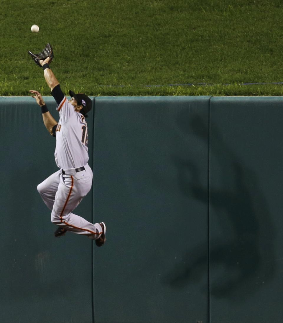San Francisco Giants' Angel Pagan goes up to catch a long fly ball hit by St. Louis Cardinals' Yadier Molina during the third inning of Game 4 of baseball's National League championship series Thursday, Oct. 18, 2012, in St. Louis. (AP Photo/David J. Phillip)
