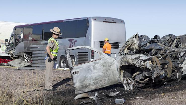 "A wrong-way pickup truck driver was killed on Interstate 10 Tuesday, Nov. 20, 2012 when the vehicle collided head-on with a tour bus, forcing the closure of all westbound lanes near Casa Grande, Ariz., authorities said.  The collision also involved a semi-truck, state Department of Public Safety officials said.  DPS spokesman Bart Graves reported ""numerous"" injuries among the 16 people aboard the bus. Among the most seriously hurt was the driver of the bus, Graves said. (AP Photo/The Arizona Republic, Mark Henle)"