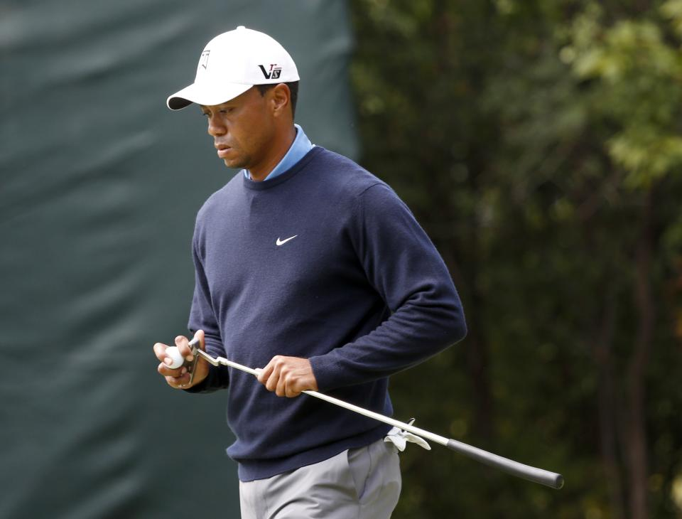 Tiger Woods walks away after retrieving his ball after his double bogey on the first hole during the second round of the BMW Championship golf tournament at Conway Farms Golf Club in Lake Forest, Ill., Friday, Sept. 13, 2013. (AP Photo/Charles Rex Arbogast)
